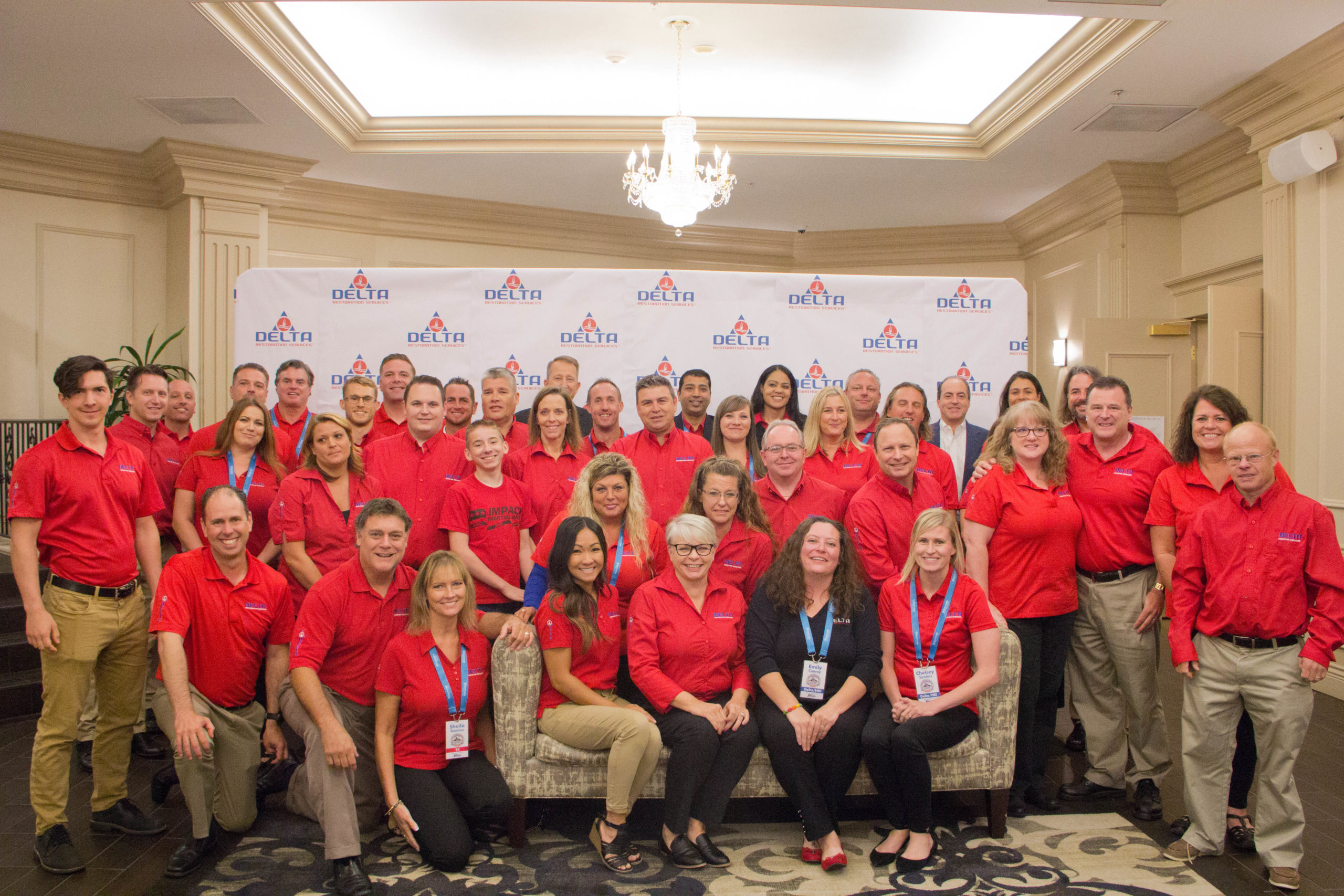 Delta franchise franchisees wearing a uniform in a group picture